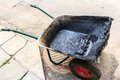 Working barrow for bitumen and hot asphalt wheelbarrow Royalty Free Stock Photos