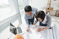 Working in bureau two vietnamese colleagues architect Royalty Free Stock Photo