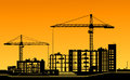 Working cranes on construction site Royalty Free Stock Photo