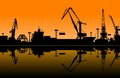 Working cranes in sea port for cargo industry design Stock Images