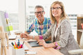 Working creative design team smiling to camera Royalty Free Stock Photo