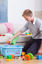 Working daddy cleaning home Royalty Free Stock Photo