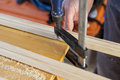 working with doorjambs using electric circular saw Royalty Free Stock Photo