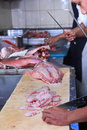 Working in the kitchen butcher Royalty Free Stock Photo