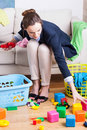 Working lady cleaning up toys Royalty Free Stock Photo