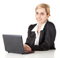Working on laptop cheering businesswoman Stock Photography