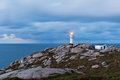 Working lighthouse at northern spain in bad weather horizontal shot Royalty Free Stock Image