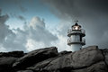 Working lighthouse at northern spain in bad weather horizontal shot Stock Photography