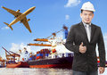 Working man and commercial ship on port and air cargo plane flyi Royalty Free Stock Photo