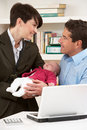 Working Mother Leaving Baby With Father Stock Images