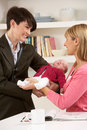 Working Mother Leaving Baby With Nanny Royalty Free Stock Image