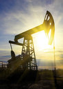 Working oil pump at sunset Royalty Free Stock Photo