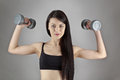 Working out with dumbbell fitness woman Royalty Free Stock Photo