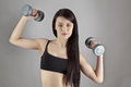 Working out with dumbbell fitness woman Stock Photo
