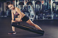 Working out sporty attractive woman in gym Stock Images