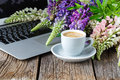 Working space or working place with laptop, flowers and coffee Royalty Free Stock Photo