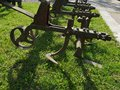 Parts of a large agricultural cultivator