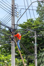 Working to install electric line