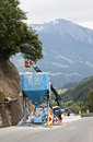 Working in the virgen valley austria workmen are flatten rocks mountains along road austrian to prevent stones are falling and Royalty Free Stock Images
