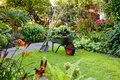 Working with wheelbarrow  in the garden Royalty Free Stock Images