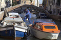 Workman coming out a boat (Venice) Royalty Free Stock Photography
