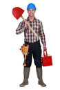 Workman holding shovel and toolbox Royalty Free Stock Image