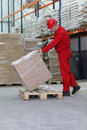 Workman lifting box on pallet