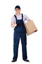 Workman in overalls hands a parcel box and blue peaked cap isolated on white transportation service Royalty Free Stock Photography