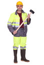 Workman with a sledgehammer heavy Stock Image