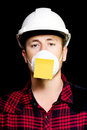Workman with a sticky note reminder Stock Photos