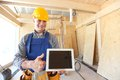 Workman with tablet Royalty Free Stock Photo