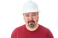 Workman or technician with a goatee beard wearing white hardhat standing looking directly at the camera isolated on white Royalty Free Stock Photography