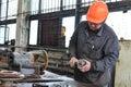 stock image of  Workman using grinder in workshop