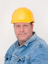 Workman wearing hardhat and jean jacket white background Stock Images