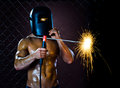 Workman welder the beauty muscular worker man weld electric arc weld on netting fence background Stock Photo