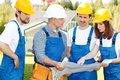 Workmen looking at house design Royalty Free Stock Photo