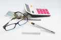 Workong environment white table or place with glasses pen calculator and money Royalty Free Stock Photo
