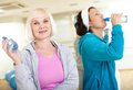 After workout portrait of aged women refreshing Royalty Free Stock Photos