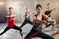 Workout with a resistance band group exercising Royalty Free Stock Photography
