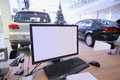 Workplace on a background of two cars with computer and christmas tree Stock Photography