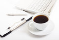Workplace bisiness white laptop and notepad and pen and coffee cup Stock Photos