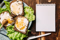 Workplace with blanck notebook, pen and sandwiches Royalty Free Stock Photo