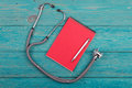 Workplace of doctor - stethoscope, medicine clipboard and pen Royalty Free Stock Photo
