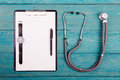 Workplace of doctor - stethoscope, medicine clipboard and watche Royalty Free Stock Photo