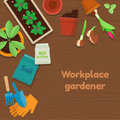 Workplace gardener and gardening tools on wooden background