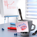 Workplace relationship romance office love affair romantic concept consisting of one mug and a note where it is written i miss you Stock Photo