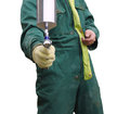 Workshop mechanic mechanicin a green suit stands with a spray gun Royalty Free Stock Photo