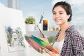 In workshop young asian woman working on painting a Royalty Free Stock Image
