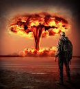 World apocalypse nuclear explosion outdoor man in gas looking on big red mushroom of environmental protection concept and the Stock Image
