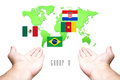 World Cup 2014 Group-A Flag with Hand and World Map background Royalty Free Stock Photo